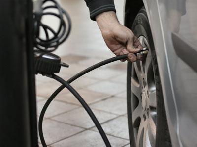 Mechanic pumping tyres